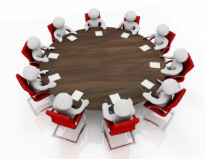 Overhead view of 3d cartoon characters holding a business meeting seated around a round table